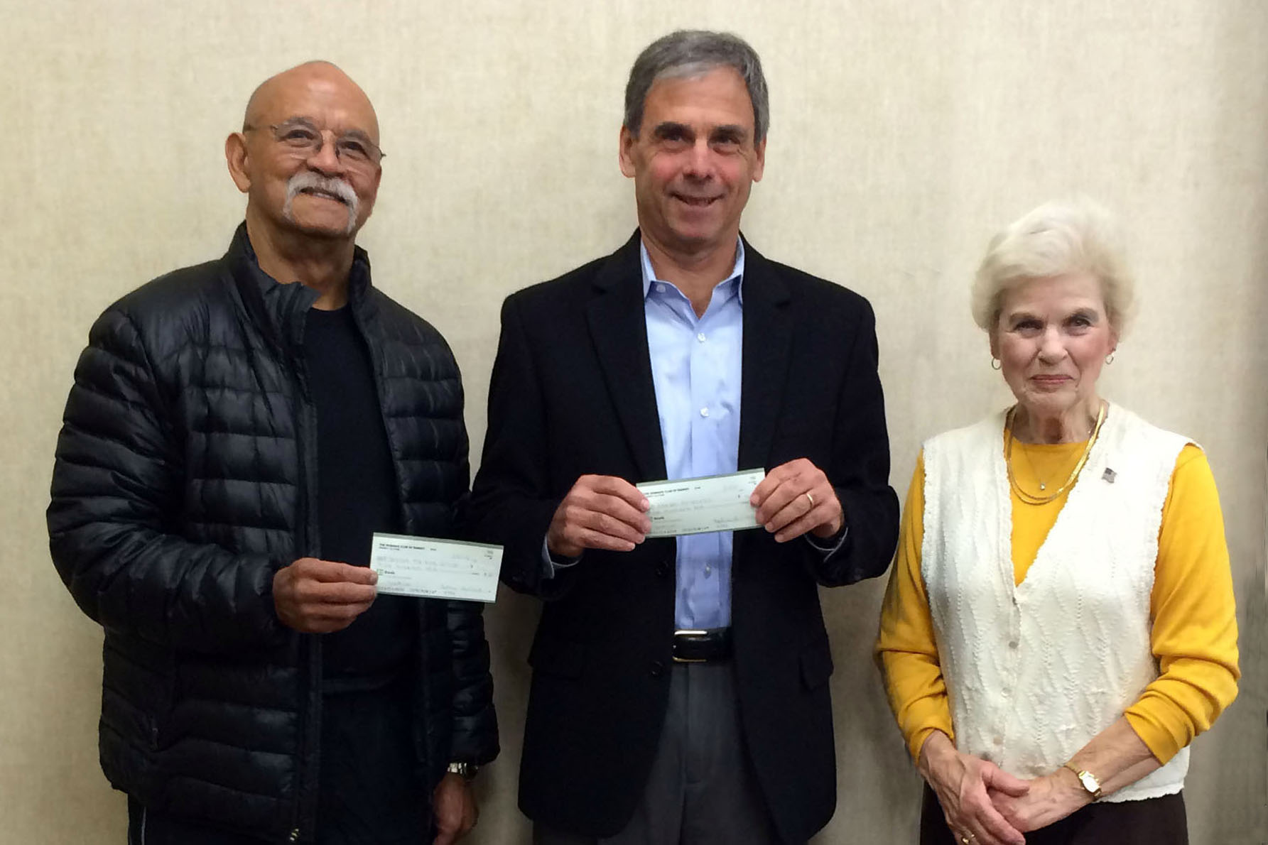 In November, Jim James and Harris Recht accepted $500 checks from Marjorie Detweiler to help support the Center for Food Action and Ramsey Responds.