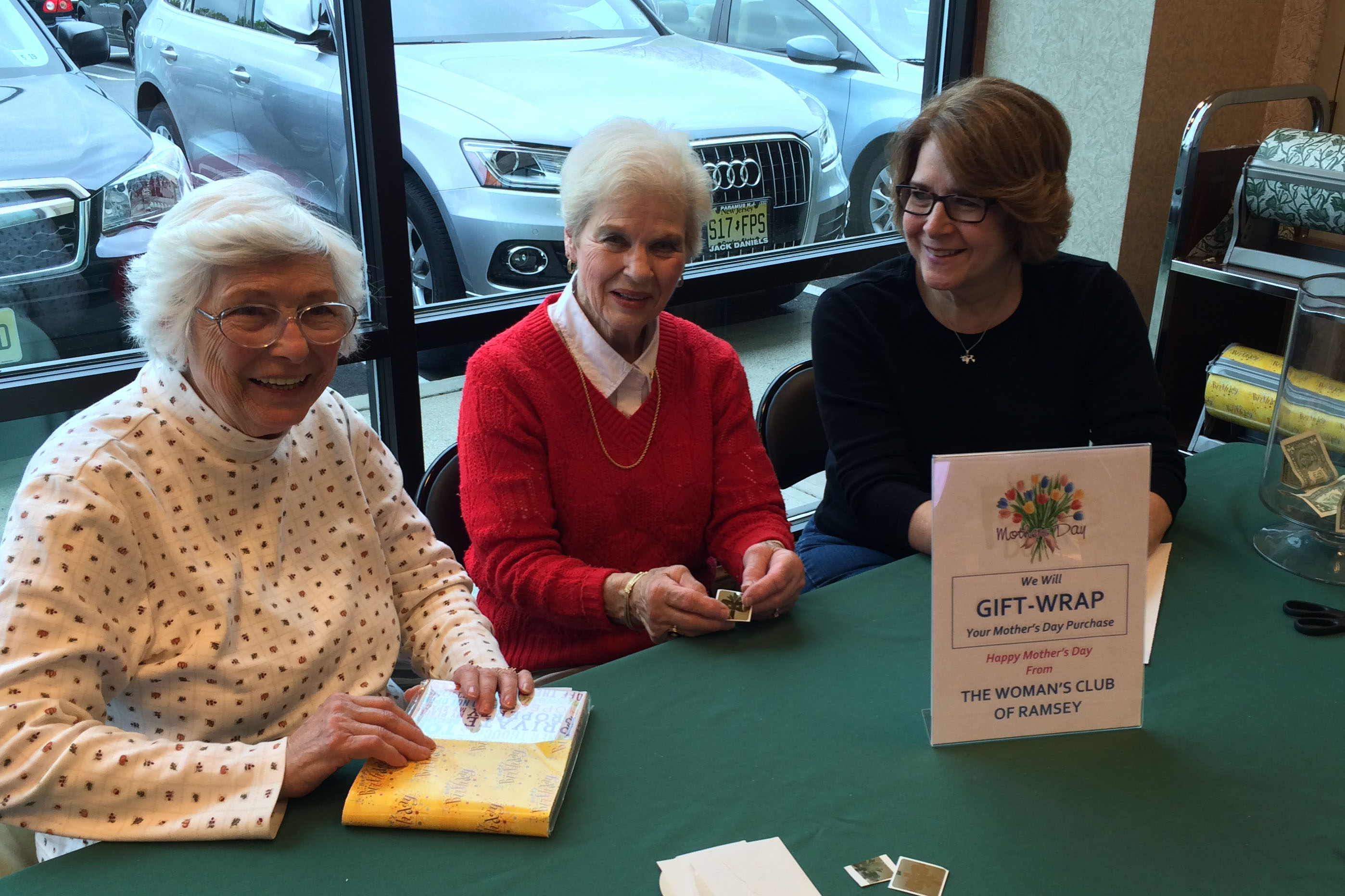 Helen Mekita, Marge Detweiler and Tannis LaManna wrap Mother's Day gifts at Barnes & Noble.