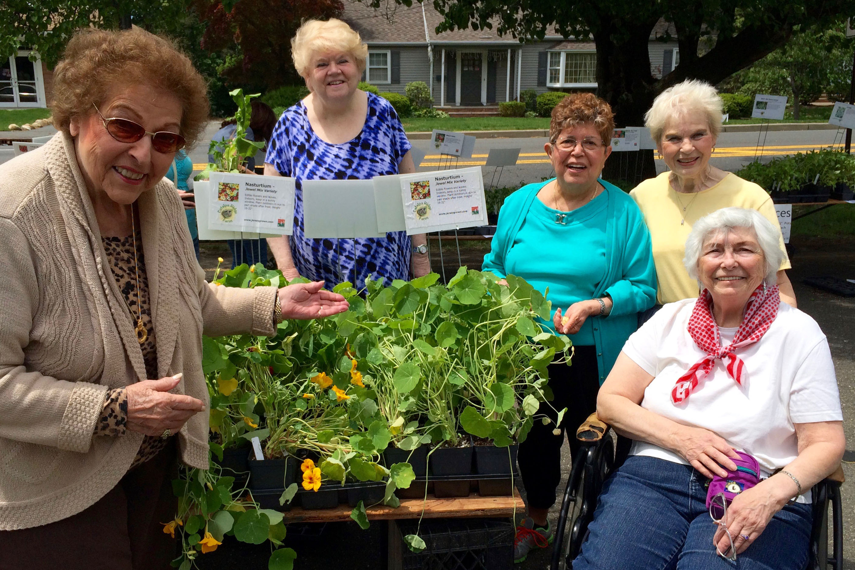 Ann Nardo, Betty Green, Julliet Borgersen, Marge Detweiler and Helen Mekita show off the nasturtiums at the May plant sale.