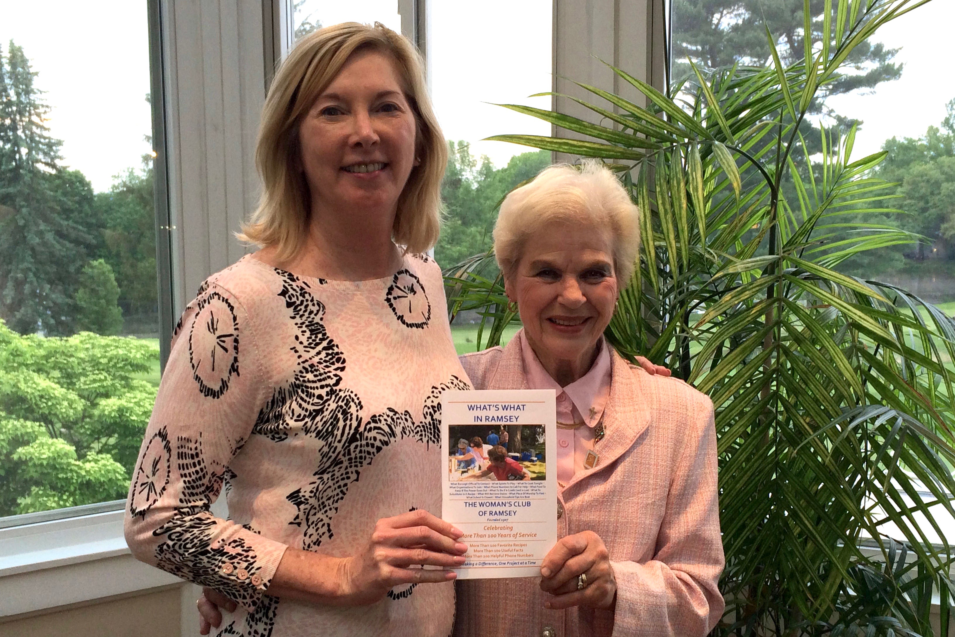 Ramsey Mayor Deirdre Dillon receives a copy of What's What In Ramsey from Club President Marjorie Detweiler at the end-of-year dinner.