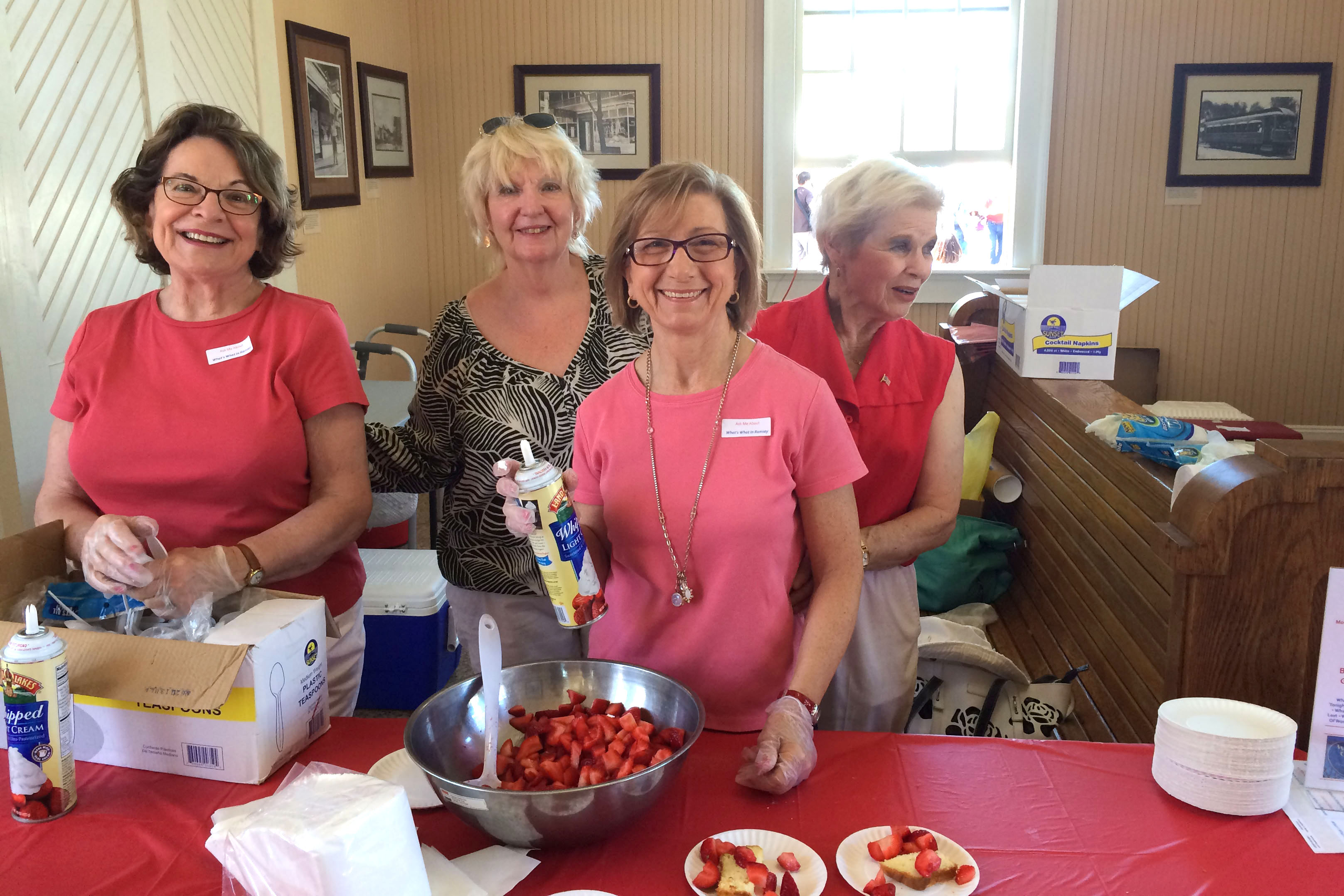During the Woman's Club Strawberry Festival, Dorothy Verdone, Pat Bernius, Toni Small and Marge Detweiler offer free strawberry shortcake at the Ramsey Farmers Market.